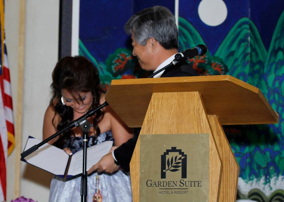 Cathlyn Choi receiving certificate of appreciation issued by the Former First Lady of South Korea